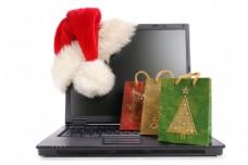 圣诞购物袋与电脑图片