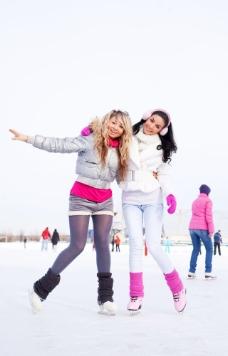 雪地溜冰美女摄影图片
