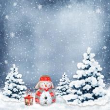 雪地上的圣诞树和雪人图片