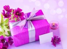 鲜花礼物蜡烛梦幻光斑背景图片